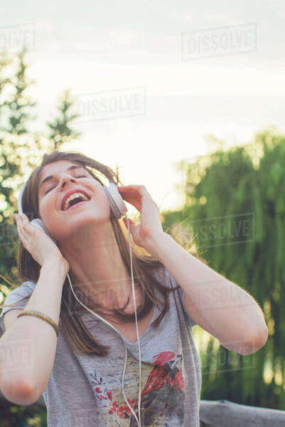 Young woman listening to music through headphones Royalty-free stock photo
