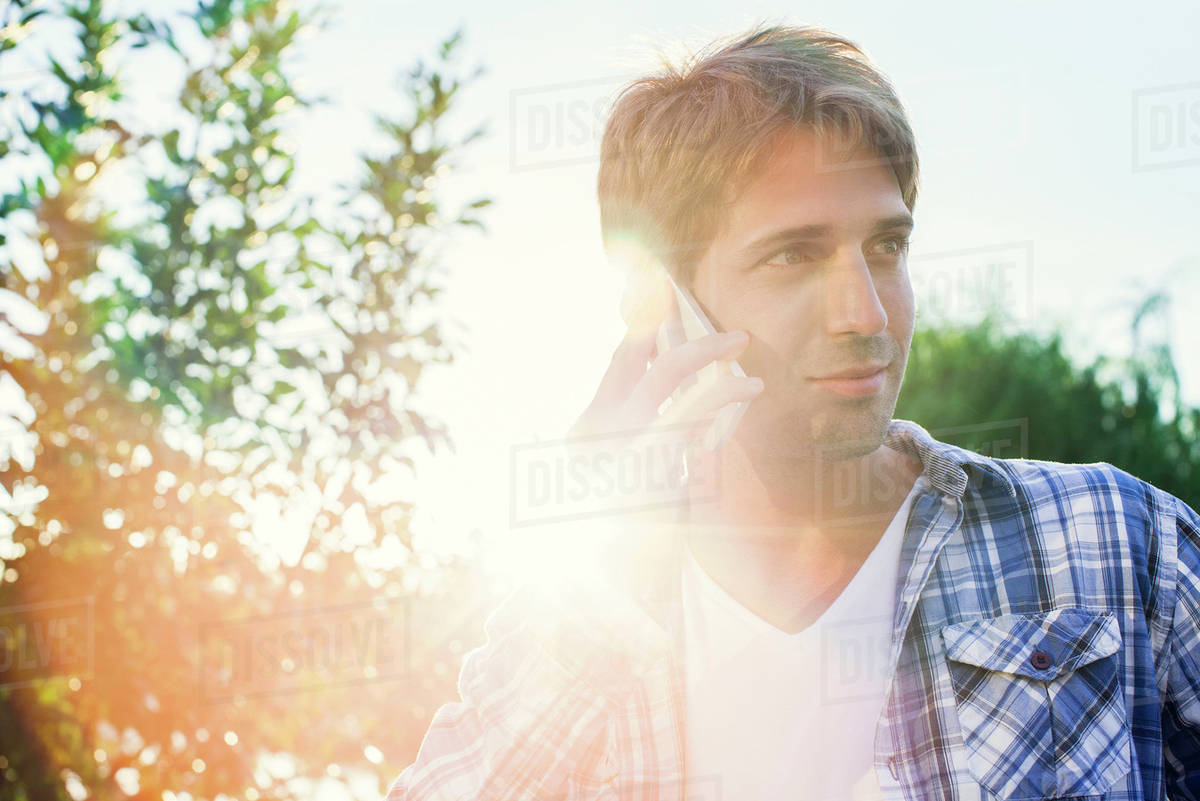 Man using cell phone outdoors Royalty-free stock photo