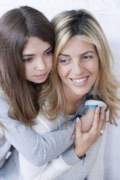 Girl embracing her mother, portrait Royalty-free stock photo