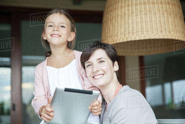 Mother and daughter using digital tablet together Royalty-free stock photo
