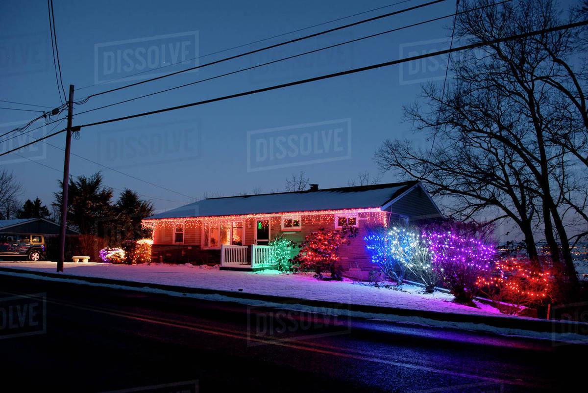 Colorful Christmas Lights On House.House Decorated With Colorful Christmas Lights Stock Photo