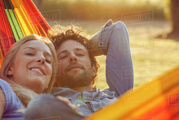 Couple relaxing together in hammock, portrait Royalty-free stock photo