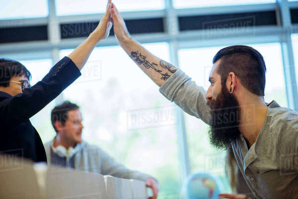Colleagues congratulating each other Royalty-free stock photo