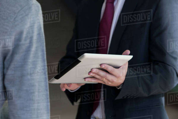 Businessmen collaborating using digital tablet Royalty-free stock photo