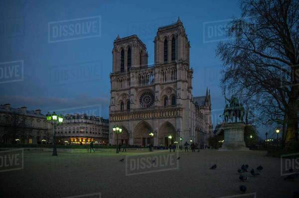 France, Paris, western facade of Notre Dame Cathedral at twilight Royalty-free stock photo