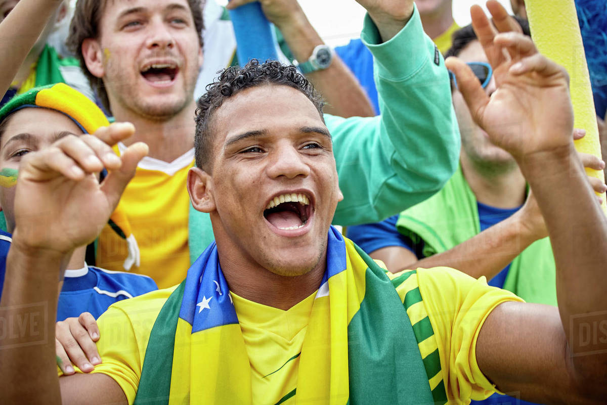 Brazilian Football Fans Cheering At Match Stock Photo Dissolve