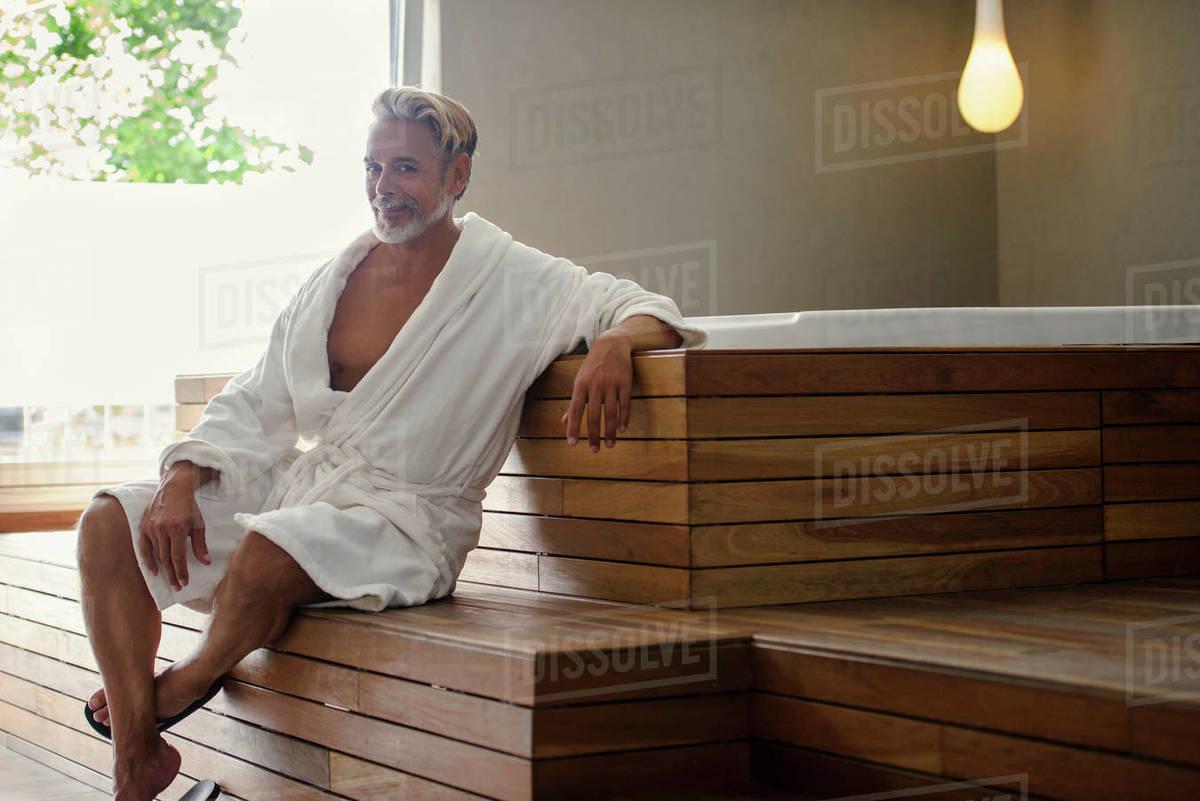 Man In Bathrobe Relaxing In Sauna Room Stock Photo Dissolve