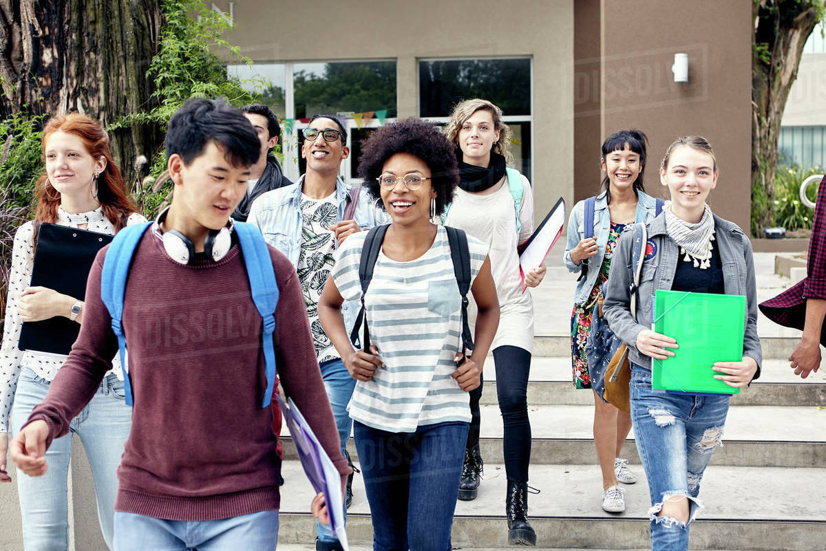College students walking on campus - Stock Photo - Dissolve