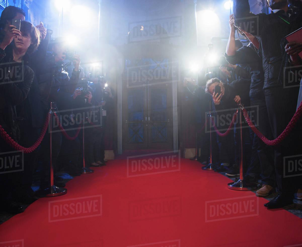 Paparazzi using flash photography along red carpet Royalty-free stock photo