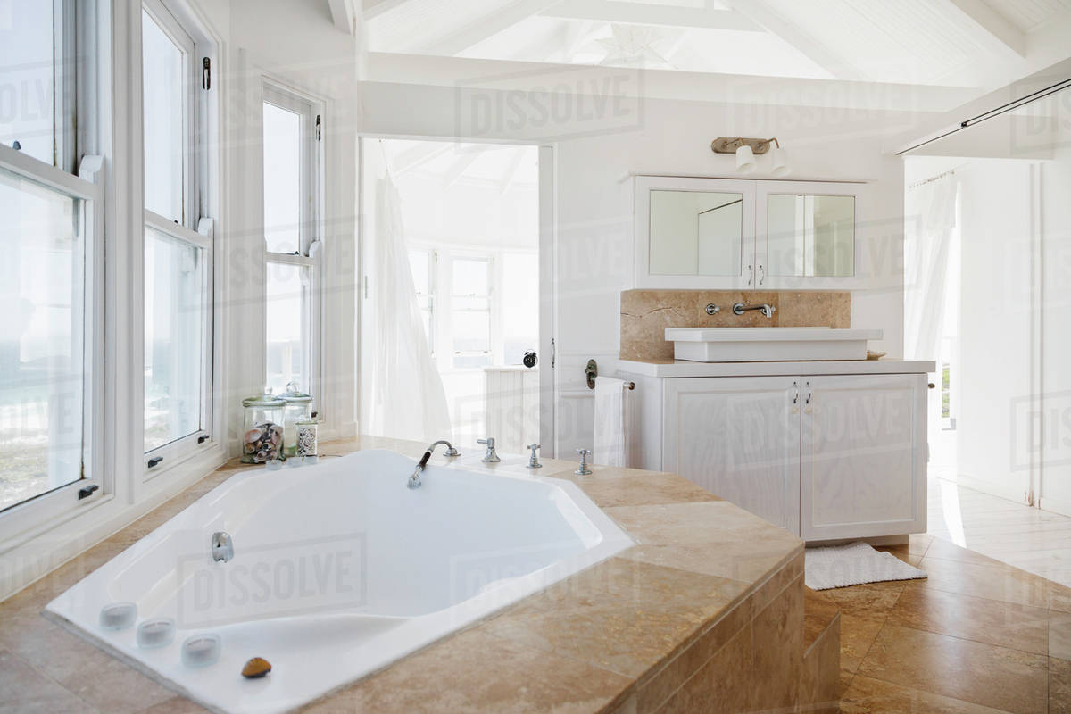 Jacuzzi tub in luxury bathroom - Stock Photo - Dissolve