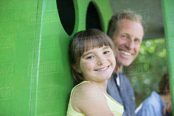 Father and daughter smiling in treehouse Royalty-free stock photo
