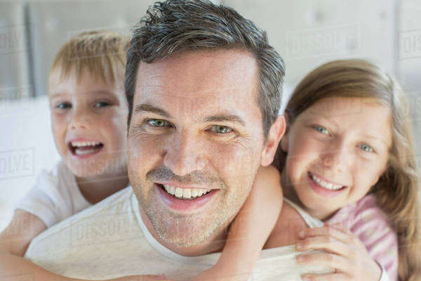 Father and children hugging Royalty-free stock photo