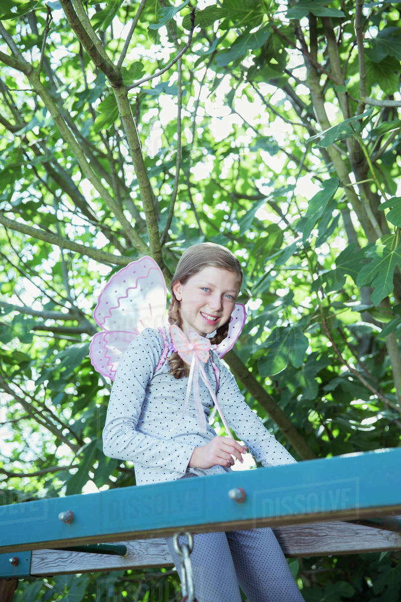 Girl smiling on monkey bars outdoors Royalty-free stock photo