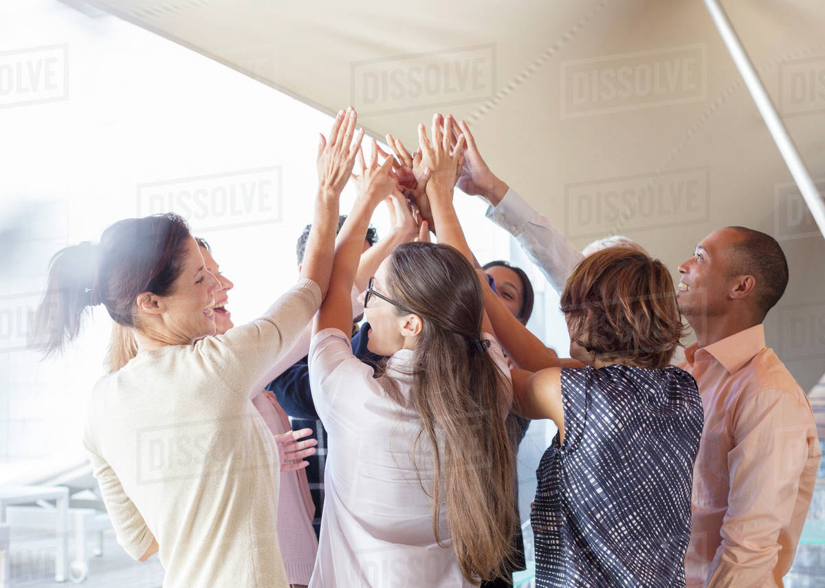 Business people cheering in office Royalty-free stock photo