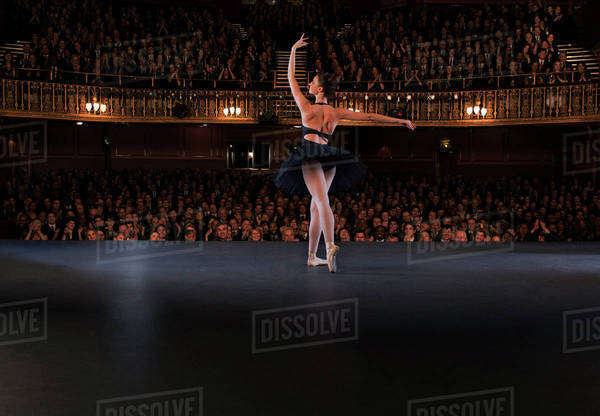 Ballet dancer performing on theater stage Royalty-free stock photo