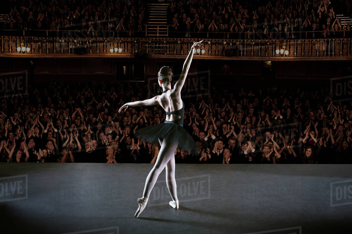 Ballerina performing on stage in theater Royalty-free stock photo