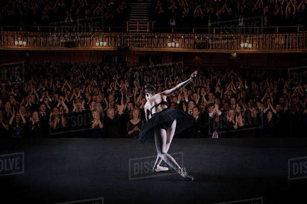 Ballerina bowing on stage in theater Royalty-free stock photo