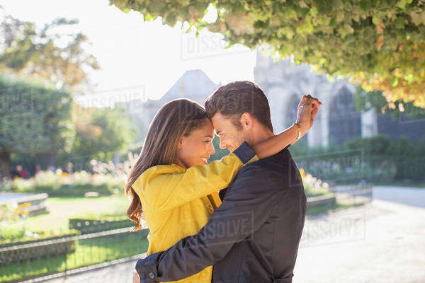 Couple hugging in urban park Royalty-free stock photo