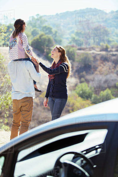 Happy family at roadside outside car Royalty-free stock photo