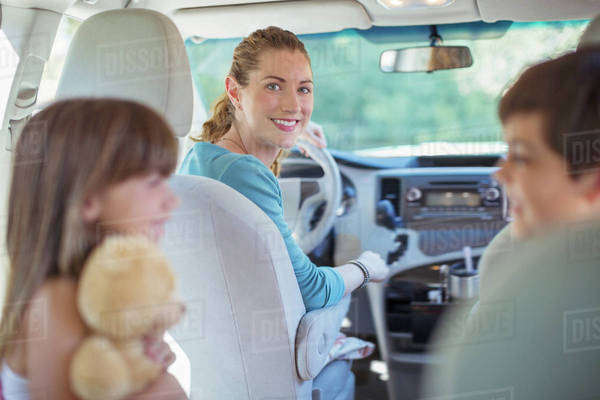 Portrait of smiling mother with family in car Royalty-free stock photo