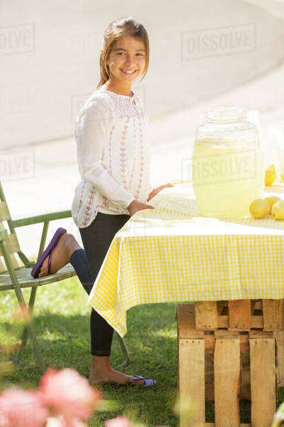 Portrait of smiling girl working lemonade stand Royalty-free stock photo