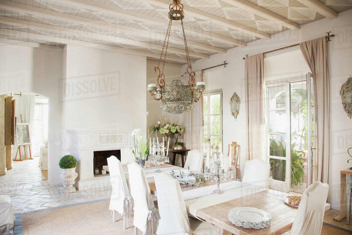 Chandelier Over Dining Table In Luxury Room