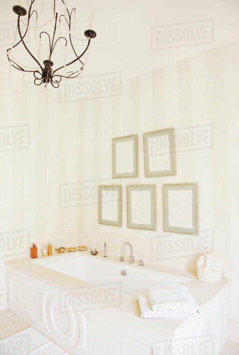 Chandelier over bathtub in luxury bathroom stock photo