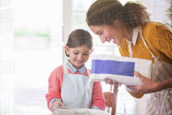 Mother and daughter baking together Royalty-free stock photo