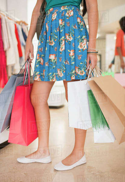 Woman carrying shopping bags in grocery store Royalty-free stock photo
