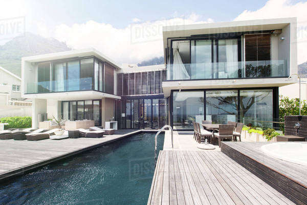 Modern house with large patio and swimming pool Royalty-free stock photo