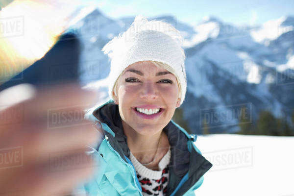 Smiling woman taking selfie in snow Royalty-free stock photo