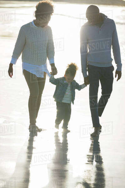 Happy family walking on beach Royalty-free stock photo