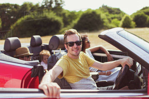 Portrait smiling man in convertible with family Royalty-free stock photo