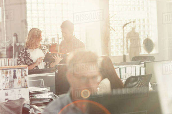 Fashion designers meeting in sunny office Royalty-free stock photo