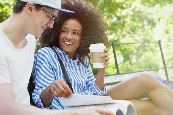 College students drinking coffee and studying in park Royalty-free stock photo
