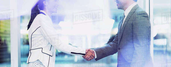Businessman and businesswoman handshaking in office Royalty-free stock photo