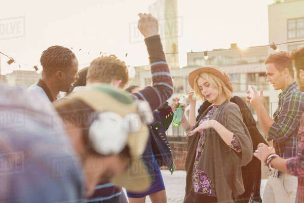Young adult friends dancing at rooftop party Royalty-free stock photo
