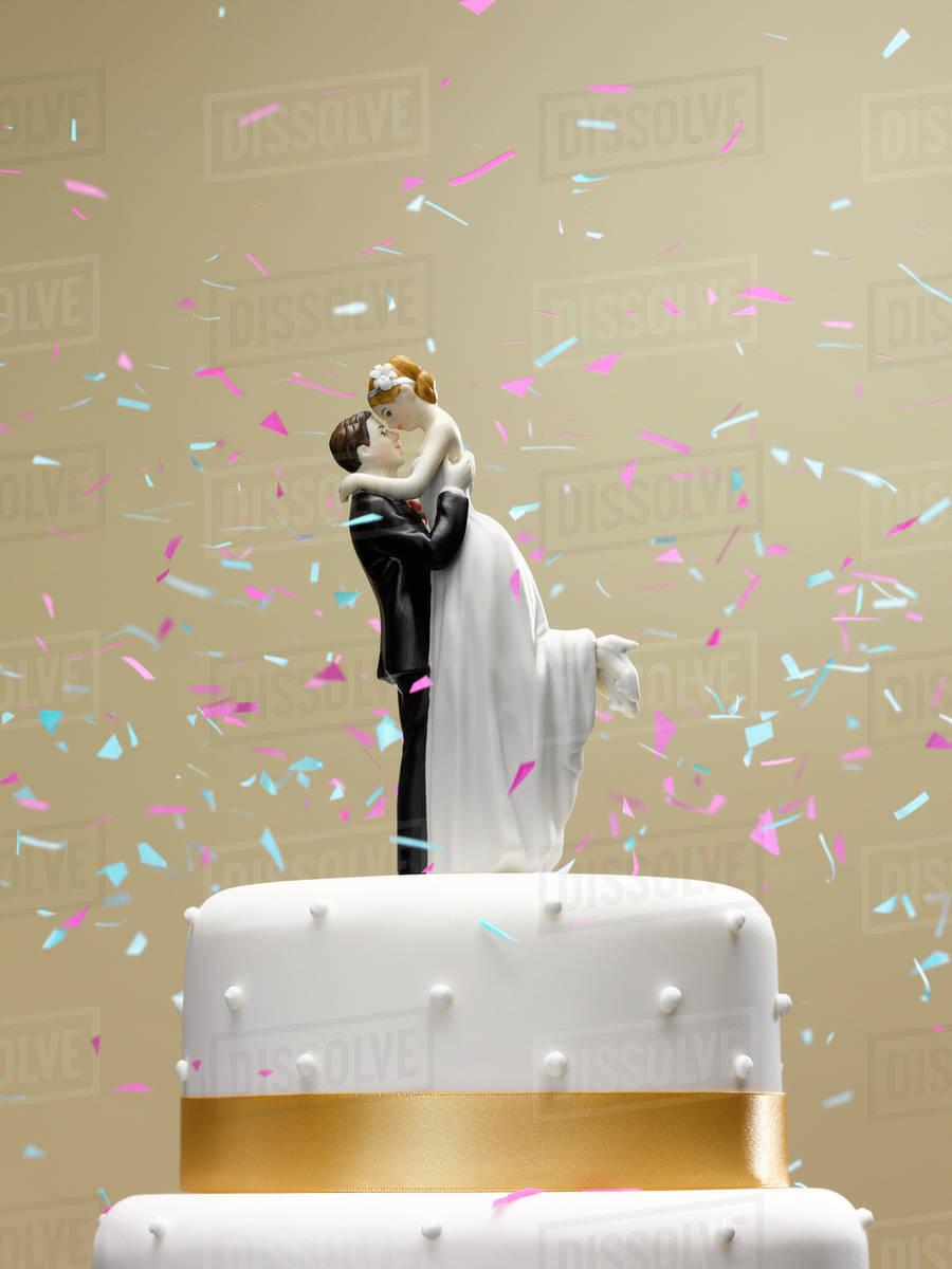 Confetti Falling On Wedding Cake