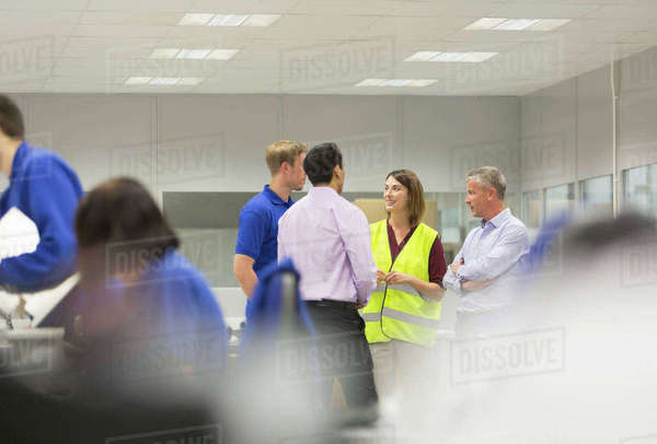 Managers and workers talking in steel factory Royalty-free stock photo