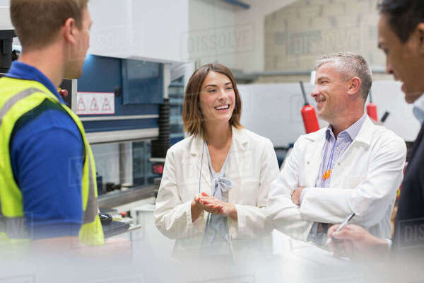 Smiling engineers and managers in steel factory Royalty-free stock photo
