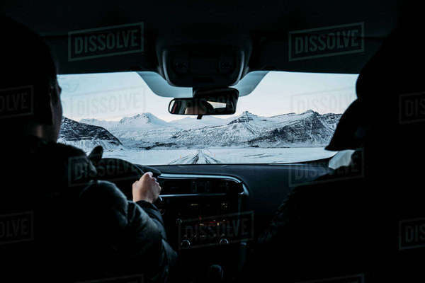 Men driving car through snow covered landscape, Iceland Royalty-free stock photo
