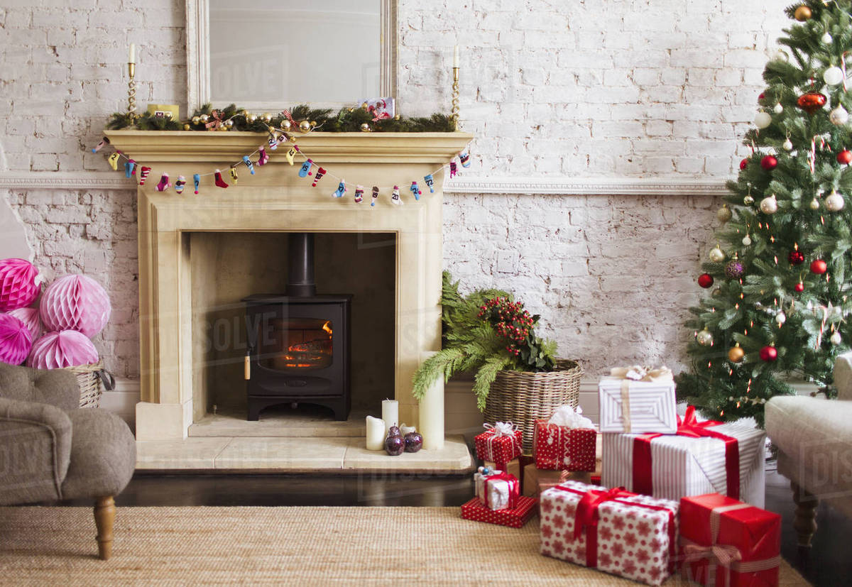 Christmas Fireplace.Christmas Tree Gifts And Decorations Near Fireplace In Living Room Stock Photo