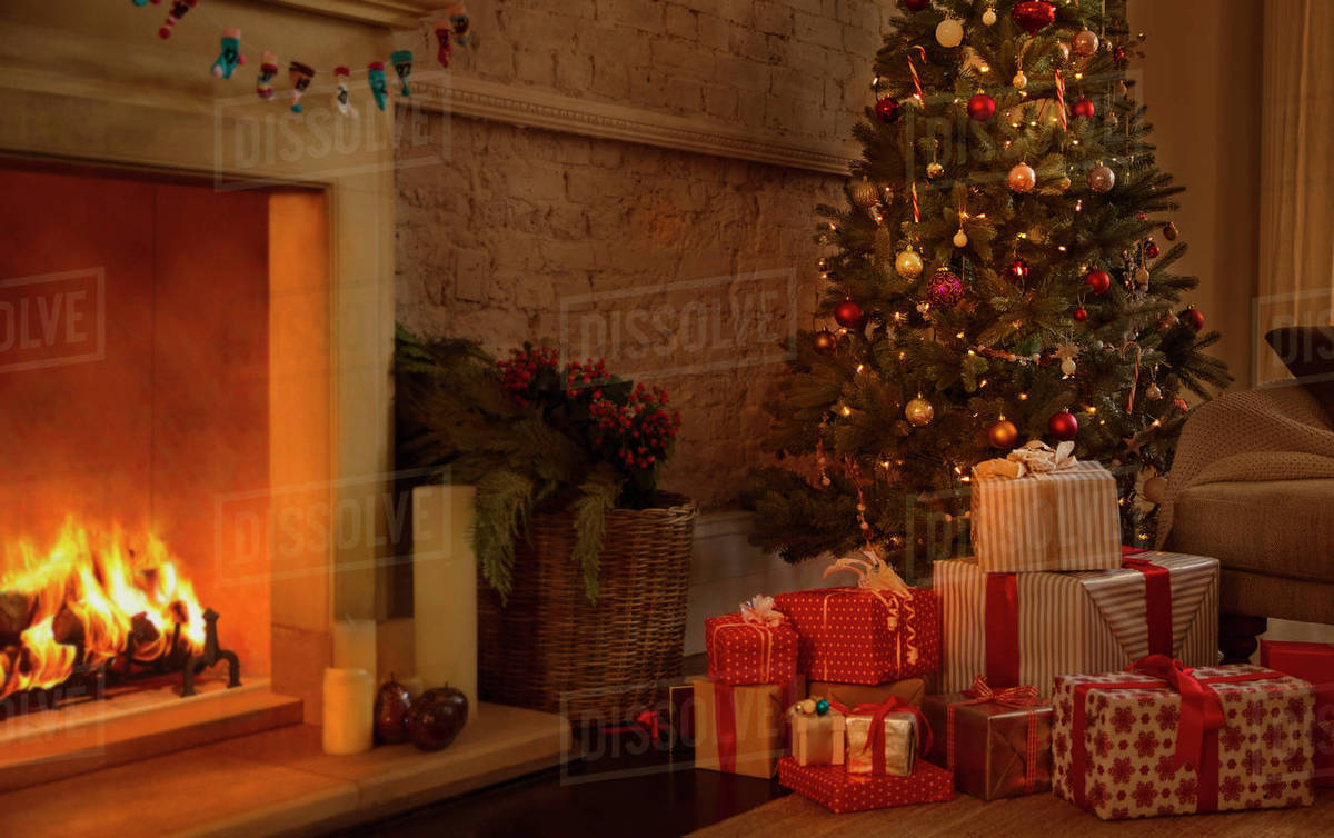 Christmas Fire Place Images.Christmas Tree And Gifts Near Fireplace In Living Room Stock Photo