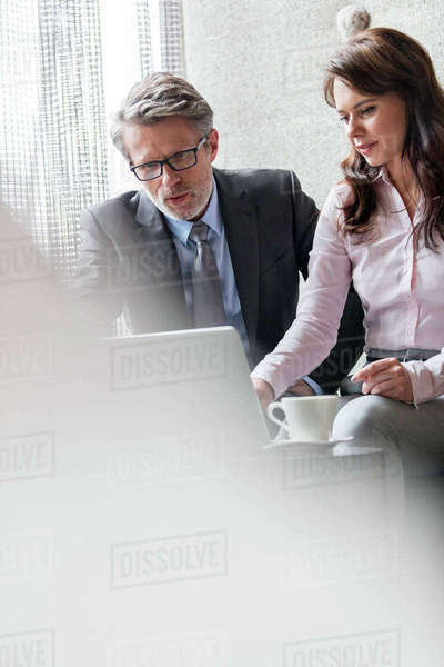 Businessman and businesswoman using laptop Royalty-free stock photo