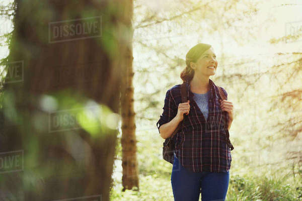 Smiling woman hiking in woods Royalty-free stock photo