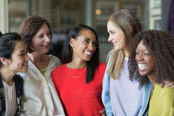 Smiling women friends talking and laughing Royalty-free stock photo