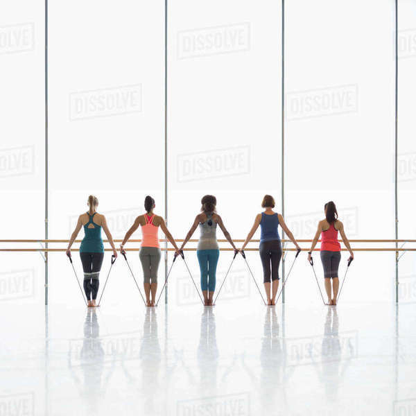 Women exercising with resistance bands in exercise class gym studio Royalty-free stock photo
