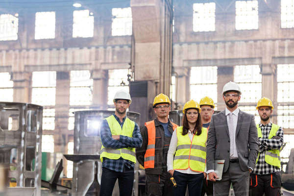 Portrait confident manager and steel worker team in factory Royalty-free stock photo