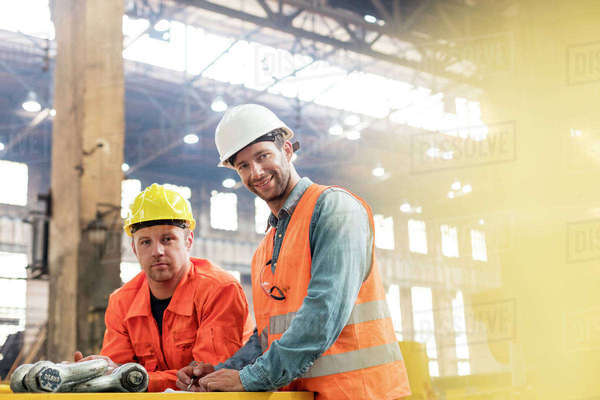 Portrait confident steel factory workers in factory Royalty-free stock photo