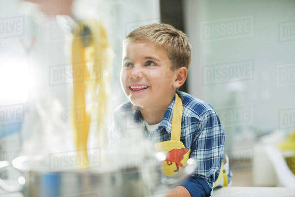 Boy smiling in kitchen Royalty-free stock photo